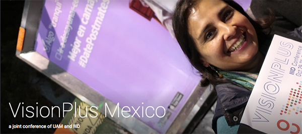 Participant at Vision Plus 2018 in Mexico holding the programme folder